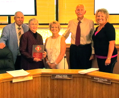 Walterscheid, Davis, Collier and Crockett pose with Flood Commissioner Louise Tracy, who is retiring June 30 after 11 years with the county. (Courtesy Photo)