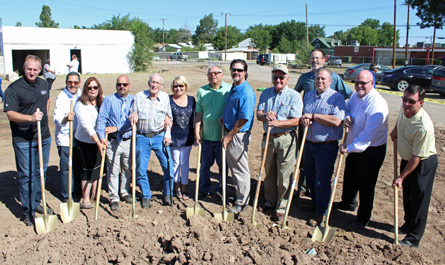 Members of Chelsea Investment Corp., the Eastern Regional Housing Authority, employees of the City of Artesia and the Chamber of Commerce, and Don Johnson, former site owner, gather this morning to celebrate a groundbreaking at the old Artesia General Hospital. A two-story apartment building will be constructed in its place, with completion set for December 2017. (Elizabeth Lewis - Daily Press)