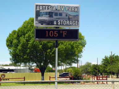 A digital sign at Artesia RV Park & Storage reads 105 this afternoon, potentially the 20th straight day the city will reach triple digits. (Teresa Lemon - Daily Press)