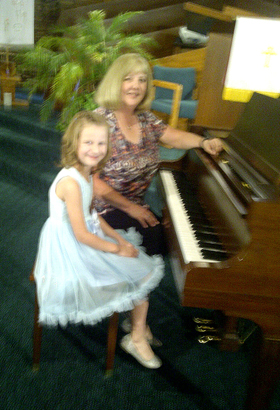 Hannah Williams poses with adjudicator Claire Troyer during Williams' first piano guild. (Courtesy Photo)
