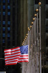 In this April 20, 1995, file photo, the American flag flies alone and at half-staff in New York's Rockefeller Plaza, honoring those killed in the Oklahoma City bombing. Lowering flags to honor numerous victims of terrorism or disasters is common practice but the category list of those receiving the honor continues to grow. (AP Photo/Mark Lennihan, File)
