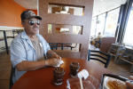 Gregory Lovato, 70, from Santa Fe, hangs out at McDonald's, talking about the old days in Santa Fe when he was growing up. (Luis Sánchez Saturno - Santa Fe New Mexican)
