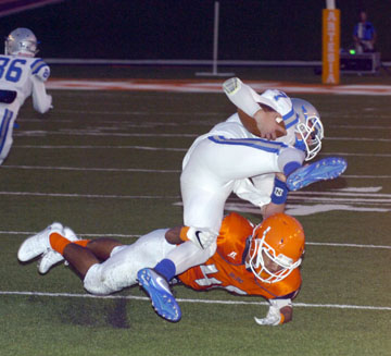 It was a rough night for Caveman QB Jonah Leyva, being tripped up by Jorge Avitia, above, and sacked by Codey Scott, below. (Brienne Green - Daily Press)