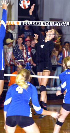 Mattie McCombs sends a kill past a Carlsbad blocker during Game Three Tuesday at Bulldog Pit. (Brienne Green - Daily Press)