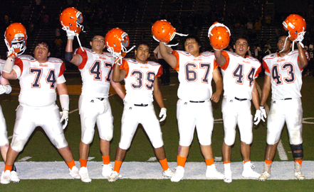 From left, Jharyss Granger, Miguel Martinez, Ulises Miranda, James Jojola, Ryan Gallegos and Bon Eric Trujillo salute the Artesia crowd Friday at Watson Stadium in Hobbs following the Bulldog football team's 56-28 win over the host Eagles. (Brienne Green - Daily Press)