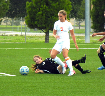 Raina Wesson prepares to fire in her fourth of five goals. (Teresa Lemon - Daily Press)