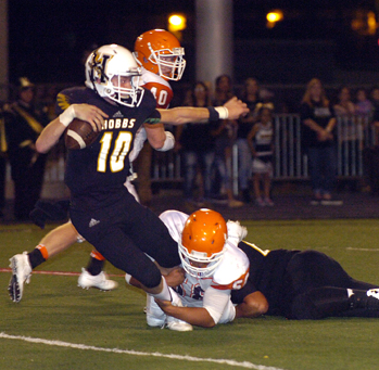 Eddie Pando sacks Hobbs quarterback Gavin Hardison Friday in Hobbs. (Brienne Green - Daily Press)