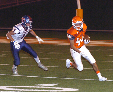 Ryan Gallegos turns the corner on a Wildcat defender. (Brienne Green - Daily Press)