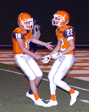 Trent Taylor (18) congratulates Chaney Hardt (22). (Brienne Green - Daily Press)