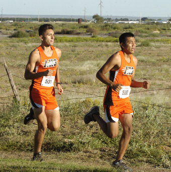Bulldogs Eliazar Granillo, right, and Julius Acosta keep pace with one another during the opening minutes of Artesia's home meet Thursday at Jaycee Park.