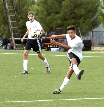 Chris Reyes launches a shot toward the goal during the second half Saturday at The Mack. (Brienne Green - Daily Press)