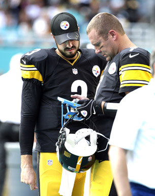Pittsburgh Steelers quarterback Landry Jones (3) talks with quarterback Ben Roethlisberger (7) during the second half of an NFL football game against the Miami Dolphins Sunday, Oct. 16, in Miami Gardens, Fla. (AP Photo - Lynne Sladky)