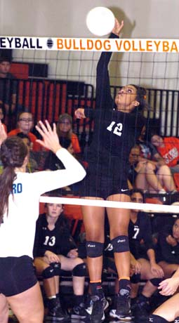 Kamryn Carrera catches the Goddard blockers off guard during Game Three Thursday at Bulldog Pit. (Brienne Green - Daily Press)