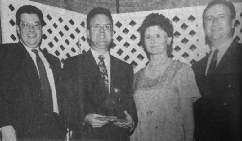 RadioShack Franchise Division Vice President and General Manager Len Clegg, left, and National Franchise Sales Manager Paul Rickels, right, are pictured with Terry's Electronics owner and operator Terry Maupin and his wife, Donna, as Maupin receives RadioShack's prestigious Circle of Excellence award. (Daily Press 1996 File Photo)