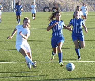 Raina Wesson takes a shot on goal during the first half Tuesday at The Mack. (Brienne Green - Daily Press)