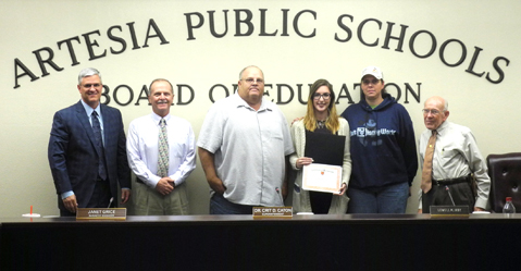 "Darian Peterson, drama student and senior at Artesia High School, displays her certificate after being recognized Monday by the Artesia Public Schools Board of Education for being selected as one of a handful of All-Festival Cast Members during the 2016 NMAA State High School One-Act Production Competition, held concurrently with the High Desert Theatre Festival in Las Cruces. Drama coach Eugene Irby recognized all participants from AHS Drama, saying, ""My hats off to you guys. This is my fourth year to coach this club, and I have enjoyed every minute of this."" Pictured with Darian is her mother, Melissa Peterson, and, from left, APS Superintendent Dr. Crit Caton, board members Jeff Bowman and David Conklin, and School Board President Lowell Irby. (Teresa Lemon - Daily Press)"