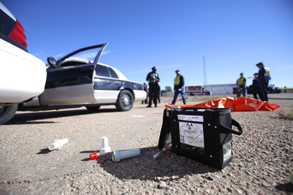 In this Thursday, Oct. 27, photo, first responders work during a mock Waste Isolation Pilot Plant truck accident at the New Mexico State Police Training Facility, in Santa Fe, N.M. This is the first time in 10 years that the training exercise has been done. (Luis Sánchez Saturno - Santa Fe New Mexican via AP)