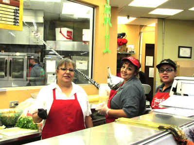 Pictured from left, deli manager Gloria Couture, Juanita Vela and Francisca Leon get ready for the lunch rush in the deli at Fenn's Country Market. (Nancy Dunn - For the Daily Press)