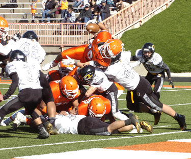 Robert Fernandez comes up just short of the goal line going up and over the pile during the second quarter Saturday at Bulldog Bowl. Fernandez finished with 77 rushing yards and two touchdowns on eight carries in the quarterfinal. (Brienne Green - Daily Press)