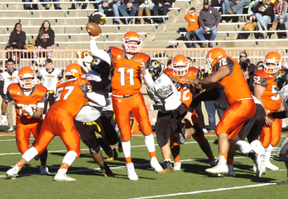 Bulldog junior quarterback Taylor Null delivers a first-down pass under pressure as the offensive line fends off Alamogordo's defensive front during the fourth quarter Saturday at Bulldog Bowl. (Brienne Green - Daily Press)
