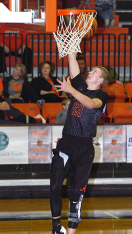 Bryce McAlister goes in for a layup during the first half Thursday at Bulldog Pit. (Brienne Green - Daily Press)