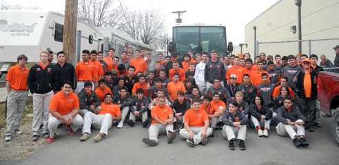 The Bulldog football team gathers outside the bus this afternoon at Bulldog Bowl prior to departing for Albuquerque. (Teresa Lemon - Daily Press)