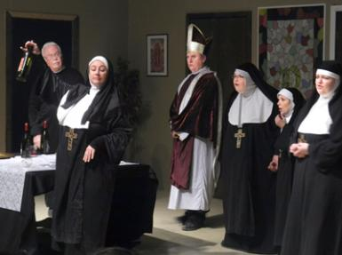 "Melynda Roberson as Sally reveals her discovery that the Sisters of Perpetual Sewing have been crafting wine on the sly as Father Chenille (Brent Hammett), Cardinal Redding (Cary Roberson), Sister Philamena (Becky Terpening), Sister Augusta (Melanie Dippel) and Mother Superior (Rebecca Griffin) look on in shock Thursday during the ACT's performance of ""Drinking Habits"" at Cottonwood Wine and Brewing. (Brienne Green - Daily Press)"