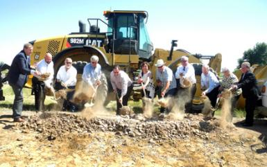 Susana Martinez, center, along with representatives of the New Mexico Department of Transportation, area lawmakers, and other officials break ground Wednesday afternoon on the U.S. 82 expansion project that will widen the highway between Artesia and Lovington. (Brienne Green - Daily Press)
