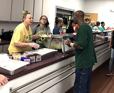 Parishioners from Trinity Temple Assembly of God serve attendees of the church's 26th Annual Love Feast Saturday at the Artesia Center. (Maegan Lemon - Daily Press)