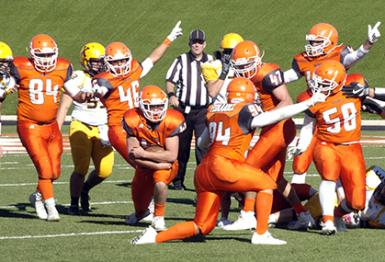 THIS WAY TO THE SEMIFINALS -- Bulldog linebacker Blake Pruitt (kneeling with the ball) makes his way off the turf with a fumble recovery as fellow defenders Aaron Flores (84), Jorge Avitia (46), Darian Fernandez (94), Miguel Martinez (47), Colin Flood (42) and Eddie Pando (58) help signal the change of possession during the first quarter of the 'Dogs' eventual 47-14 state quarterfinal win over St. Pius Saturday at Bulldog Bowl. With the victory, Artesia advances to next week's semifinals. They'll travel to Farmington for a 1 p.m. game against the No. 4 Scorpions. (Brienne Green - Daily Press)