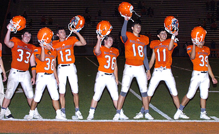 775fc50de2f Members of the Bulldog football team salute the crowd with the Artesia High  School Alma Mater following Friday s game. (Brienne Green – Daily Press)