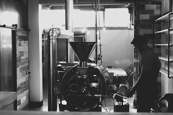 Rob Morrisey, owner of Kith + Kin Roasting Co., makes adjustments to the coffee roast profile in the local shop's roastery. (Courtesy Photo)